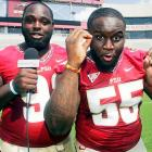Doing interviews is also a college football tradition. When there are no media around to interview them, players keep in practice by interviewing each other, as these two Florida State defensive tackles are doing in Tallahassee.