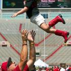 """Legendary head coach Darrell Royal once said """"Three things can happen when you throw the ball, and two of them are bad."""" The same is true when you throw the three-year-old granddaughter, as Roger Schmidt found out at Memorial Stadium in Lincoln, Neb."""