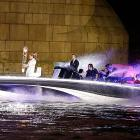In true James Bond-ian fashion, the soccer celeb arrived in London at the helm of a speedboat named Max Power carrying a torch for the Summer Games.