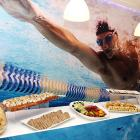 London's the place where swimmers can go for the gold or the grub at the media event for international journalists.