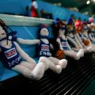 British team dolls, which appear to be of the voodoo variety, await the Australians and their hatpins before the women's Group B preliminary round match.