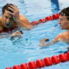 Ever the thoughtful teammate, Mr. Lochte appears to have informed the illustrious Mr. Phelps that he'd forgotten to remove his wallet from his back pocket before taking to the pool in single-minded pursuit of yet another medal.