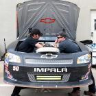 It is our misunderstanding that NASCAR's next generation of cars will have crew members housed under the hood to reduce the need for time-consuming pit stops.