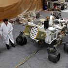 "A shocking photograph from NASA's Jet Propulsion Laboratory in Pasadena, Calif., where the elaborate exploration of the Angry Red Planet is being staged, much to the great excitement of scientists, eggheads and the general public everywhere. (Frankly, we smelled a hoax when the rover ""transmitted"" photos of the Rose Bowl shortly after ""landing"".)"