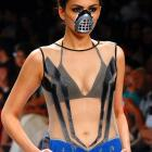 In Mumbai, India, a model presents a creation by designer Abhishek Dutta inspired by Bane, the villain of the recent major motion picture  The Dark Knight Rises .