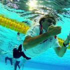 Croatia's coach ended up in the drink while celebrating his team's 8-6 triumph over Italy in the men's Olympic water polo gold medal match.