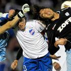 Uruguay's Nacional's Jorge Bava and Alexander Medina, and Chile's Deportes Iquique's Boris Rieloff make like the Three Stooges during their match in Montevideo.