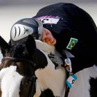 Shagged out after completing the equestrian show jumping stage of the Olympic women's modern pentathlon, the Brazilian rider nods off on her steed, Over The Odds.