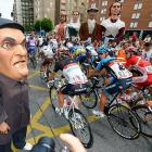 Under the watchful eye of officials from the World Anti-Doping Agency, the pack roars through second stage of the big cycling race between Pamplona and Viana.