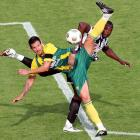 Shola Ameobi of Newcastle United challenges Gabor Harvath of ADO Den Haag for a ball at the edge of the box.  The teams played a preseason friendly in Den Haag, Netherlands.