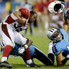 Arizona running back William Powell (33) loses his helmet after absorbing hits from Tennessee's LaQuinton Evans and Aaron Francisco. The Titans beat the Cardinals 32-27.