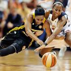 The Tulsa Shock's Ivory Latta and Connecticut Sun's Allison Hightower tangle for a loose ball. Connecticut won 82-80 in overtime.