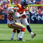 Denver's Knowshon Moreno puts a devastating stiff arm on San Francisco's Michael Thomas in an NFL preseason game in Denver.