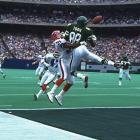 Jets receiver Al Toon leaps for a catch against the Bills in 1991.