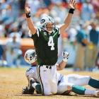 Brett Favre raises his hands in celebration after throwing a touchdown in Miami during the season opener.
