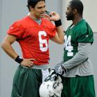 Quarterback Mark Sanchez talks with Darrelle Revis during a practice at the new Meadowlands Stadium in 2010.