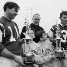 Jim Turner (left) and Don Maynard are presented trophies during a December 1968 game.