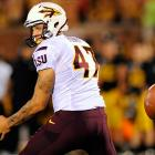 Get thee behind me: Arizona State's punter had a Sun Devil of a time with a snap in the third quarter of a 24-20 loss to Missouri. The metaphysically elusive pigskin slipped through his hands and rolled over his head, ultimately giving the Tigers possession.