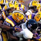 Bass fed to Tigers: Vandals running back Ryan Bass is caught in the teeth of LSU's defense during a fourth down carry in the first half of Idaho's 63-14 loss.