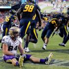 The end is near: James Madison's tight end sat on his end in the end zone after a pass intended for him was picked off by West Virginia linebacker Tyler Anderson (53) during the second half in Landover, Md. West Virginia won going away, 42-12.
