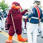 Virginia Tech's wily mascot makes his play for a band member before a game against Bowling Green at Lane Stadium in Blacksburg, Va.