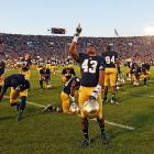 Cornerback Josh Atkinson points out the location of the Big Kahuna, or perhaps the blimp in the next frame, before he and his mates are thrown to the Wolverines at Notre Dame Stadium.