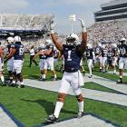 Bill Belton (1) pumps up the crowd before Penn State's game against Ohio.