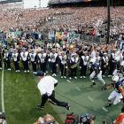 Bill O'Brien leads his team onto the field at Beaver Stadium.