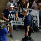 Enthusiastic fans show their support as Bill O'Brien and the Nittany Lions enter the team facilities.