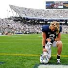 Backup Penn State quarterback Shane McGregor kneels after his team's opening weekend home loss to Ohio.