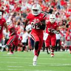 Louisville let a 36-7 lead melt away, but ultimately held on to beat UNC 39-34. Cardinals quarterback Teddy Bridgewater had another huge day, completing 23-of-28 passes for 279 yards and three touchdowns, including one to Eli Rogers (pictured). Bridgewater has now completed 72 of his 88 attempts on the season for an astounding 82-percent completion mark.