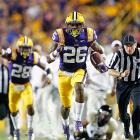 LSU defenders had their hands in the air even before they started celebrating interception returns for touchdowns. Tigers safety Ronald Martin (No. 26) and defensive end Lavar Edwards each snagged deflected passes and returned them for scores, helping LSU pull away for an easy victory over winless Idaho.