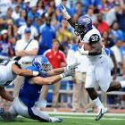 TCU made its Big 12 debut in style, taking down Kansas to improve to 2-0. Junior Waymon James (pictured) led the rushing attack with 12 carries for 99 yards, and wideout Brandon Carter made eight catches for 141 yards and two scores. Quarterback Casey Pachall wasn't bad, either. He completed 24-of-30 passes for 335 yards and two touchdowns. On the season, Pachall has now completed 33-of-39 attempts, an 84.6 percent mark.