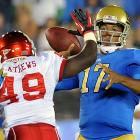 """No. 22 UCLA showed what it can do on offense in its first two games of the season, rolling up 85 points and 1,299 yards. Redshirt freshman Brett Hundley (right) passed for 320 yards and two touchdowns, and the hard-hitting Bruins held high-scoring Houston in check. """"We played outstanding defense tonight except for one play,"""" said first-year coach Jim Mora, referring to an 86-yard run by Houston's David Piland with 4:54 remaining that kept the Cougars from being shut out for the first time in nearly 12 years."""