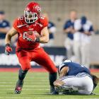 Two years ago, BYU saw its hopes of winning in Salt Lake City dashed by a last-second blocked field goal. Saturday night, the 25th-ranked Cougars had two late chances only to have the same result, this time a loss to Utah. The Utes' Star Lotulelei blocked Justin Sorensen's 51-yard attempt with 1 second remaining after the officials put time back on the clock following a third-down incompletion. The Cougars would get another shot, from 15 yards closer after the frenzied crowd prematurely rushed the field, and Utah was assessed a penalty. Riley Stephenson's 36-yard attempt with no time left clanked off the left upright, sending the crowd back on the field for good to celebrate the upset. Jake Murphy (left) and 2-1 Utah travel to Arizona State to face the Sun Devils.
