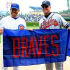 Cubs pitcher Ryan Dempster presented Chipper with the Braves flag that once flew on the standings flagpole above Wrigley Field.