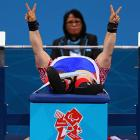 Russia's Tatiana Smirnova prepares to demonstrate the devilish digital press in the Women's 52-kg powerlifting event in London.