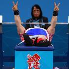 Russia's Tatiana Smirnova prepares to demonstrate the devilish digital press in the Women's 52-kg powerlifting event in London.