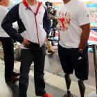 We almost didn't recognize him with his clothes on, but here's everyone's   favorite au naturel pool playa   sharing a yuk with athlete Derek Derenalagi at the Aquatics Centre in London where he watched the swimming heats on Day 6 of the Paralympic Games.