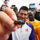 The tennis star, seen here at the U.S. Open, will gladly sign your face if you hold still long enough.
