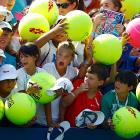 A contingent of urchins with a clear stake in the sports memorabilia market awaits Serena Williams after her win over Ekaterina Makarova at the U.S. Open.