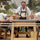 Warring digits in Warngau: In this traditional rural sport, the winner must pull his foe over the marked line on the table, just like in the NHL Collective Bargaining negotiations.