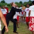 """Prince William enjoys a little game of calle te ano (""""make the staid Englishman run around the field with the old cabbage"""") in Funafuti, Tuvalu, during the Royal couple's Diamond Jubilee all-out invasion of the Far East."""