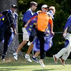 Team Europe fans, or escapees from the local asylum (your choice), grace the fairway.