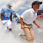 New North Carolina head coach Larry Fedora leads his team onto the field before the Tar Heels' opening game against Elon.
