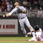 Seattle Mariners infielder Pedro Florimon makes a throw to first while avoiding Minnesota Twins outfielder Darin Mastroianni's takeout slide during the Mariners' 5-2 win.
