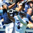 BYU wide receiver Cody Hoffman catches a touchdown pass over Weber State cornerback Devin Pugh in the first quarter. It would be one of many in BYU's easy 45-13 win.