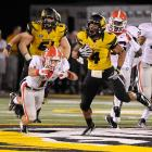 Missouri's Kendial Lawrence eludes the grasp of Georgia free safety Connor Norman. The Tigers took a 10-9 lead at halftime of their SEC debut, but Mark Richt's Bulldogs would overwhelm Missouri, 41-20.