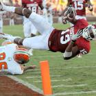 Oklahoma wide receiver Justin Brown tries to return a punt for a touchdown but is forced out of bounds by Florida A&M punter Branden Holdren during the Sooners' 69-13 win over Rattlers.