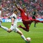 Bayern Munich's Mario Mandzukic is challenged by Zdenek Pospech of Mainz during a game in Munich.